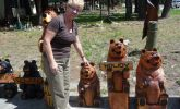 Rayls loves these wooden bears - too big to bring home